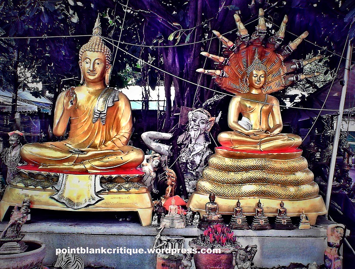 Thai Superstition A shrine with two gold statues