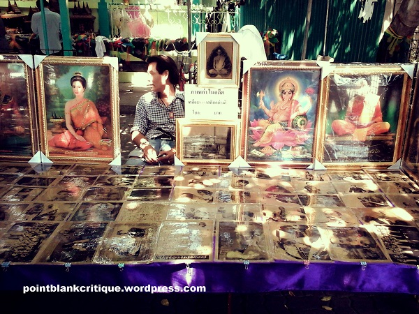 This vendor sells holy pictures and other items for prayers